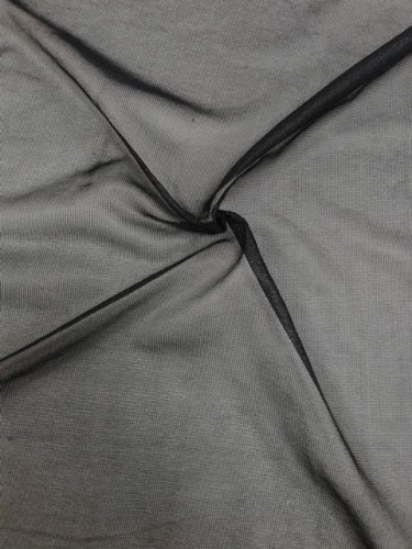 J050/23 Дублерин трикотажный 50г/м точечный 150см цв.черный(в рул.100м)
