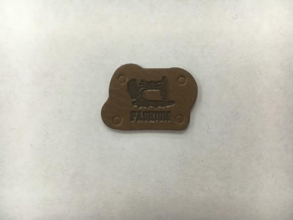 68006Y нашивка кожзам 2*1,8см(в упак.100шт)