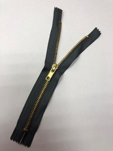Молния джинсовая Т5 18см неразъемная золото цв.№312 т.серый(в упак.100шт)