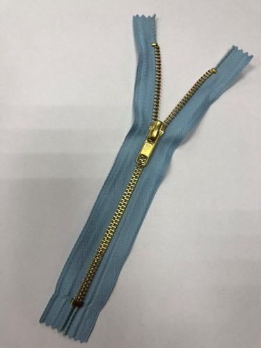 Молния джинсовая Т5 18см неразъемная золото цв.№184 голубой(в упак.100шт)